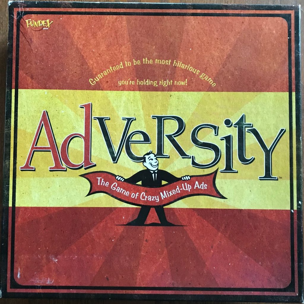 "Cover just says Adversity with Max Madison holding a banner saying, ""The game of crazy mixed-up ads"""