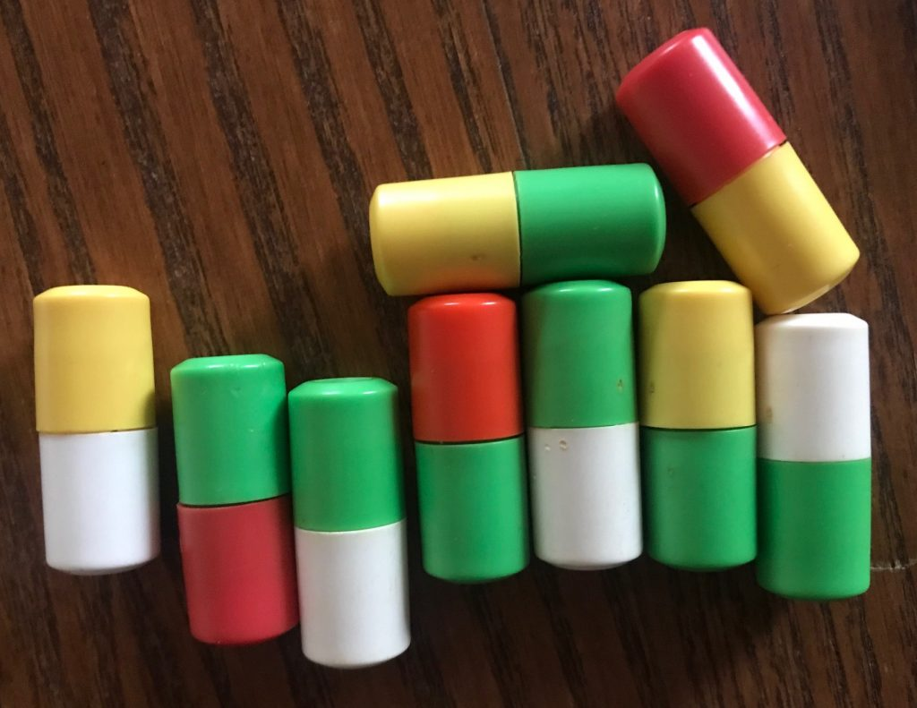 The pegs are two colors, like yellow/white, green/red, green/white, etc