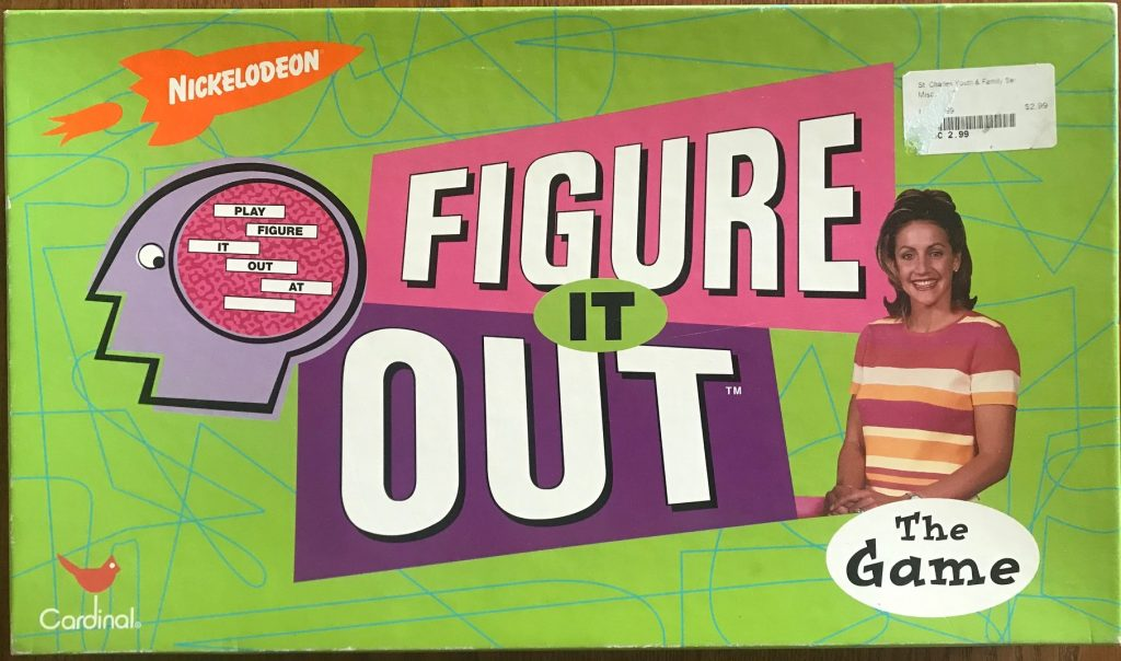 Cover shows Billy the answer head on the left side, hostess on the right side, and the Figure It Out name in the middle