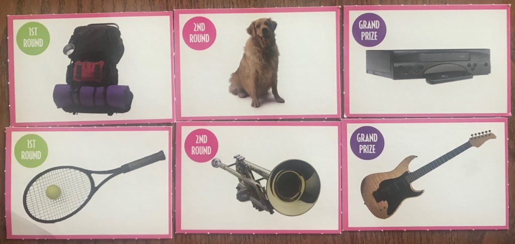 The prizes include tennis racket, dog, electric guitar