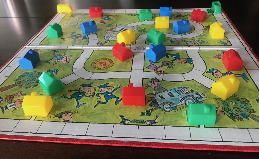 The board set up for play showing houses all over the board