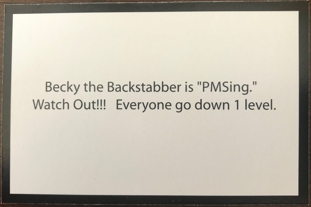 This card says one of the characters is PMS'ing so everyone goes down one level
