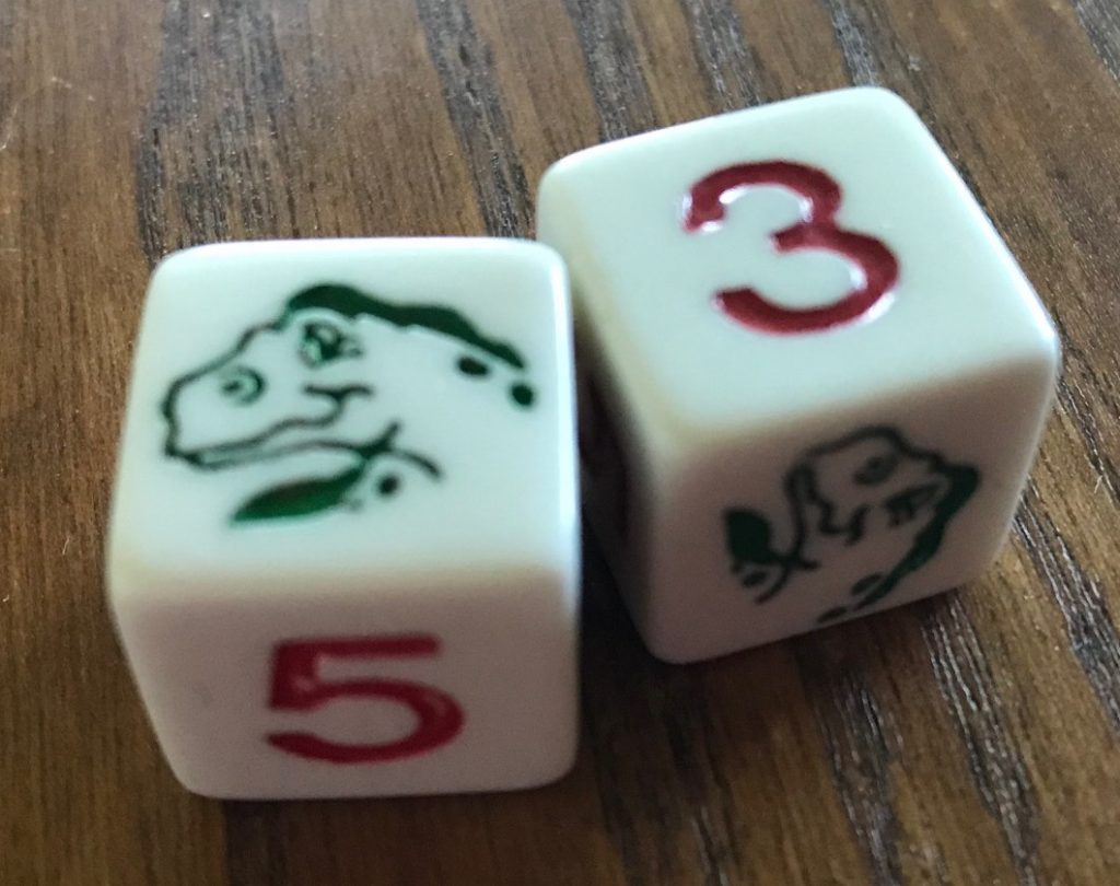Two dice showing red numbers or green dinosaurs