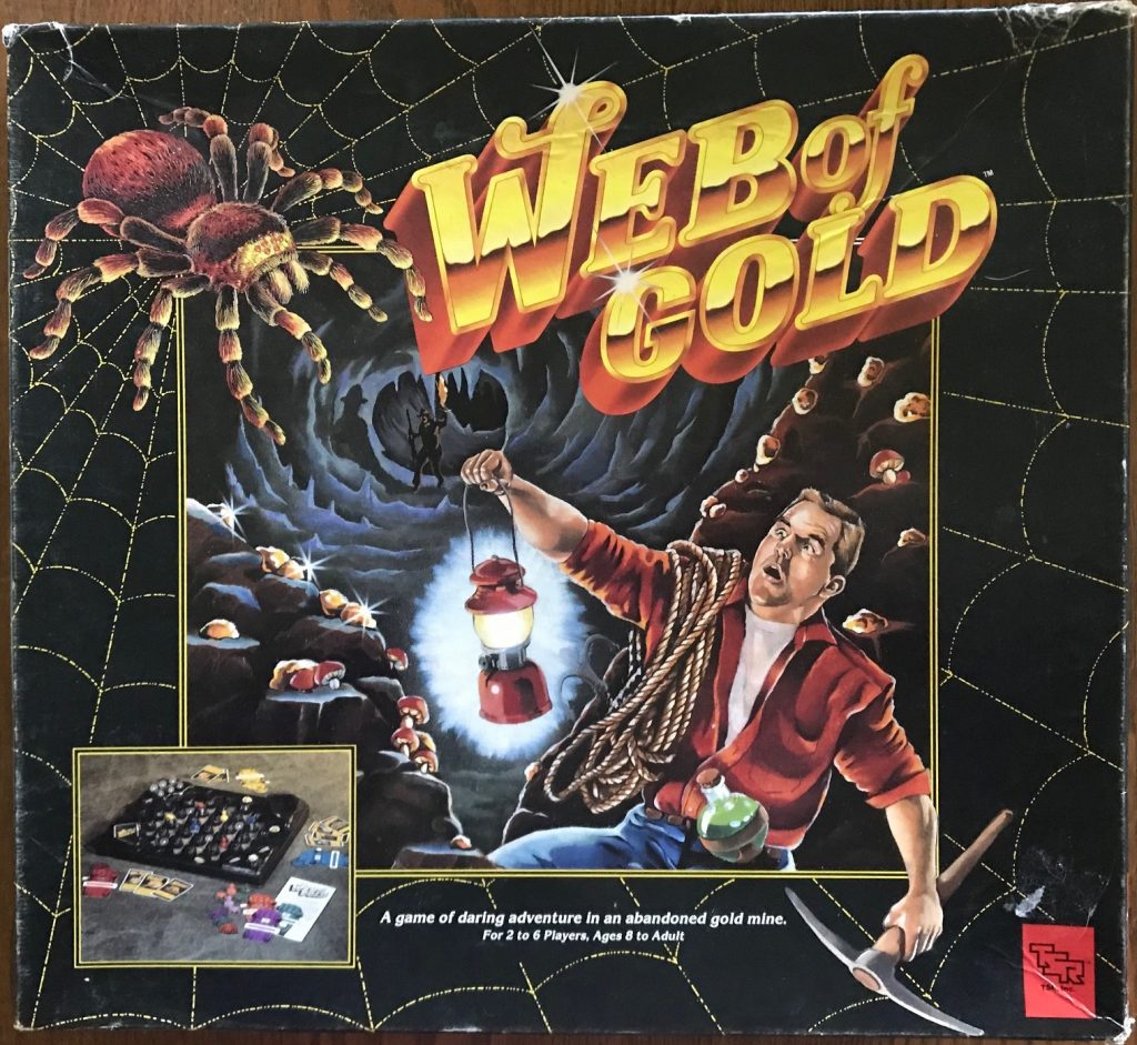 The cover says Web of Gold in big gold letters with a giant spider and a man running down a mine holding a lantern