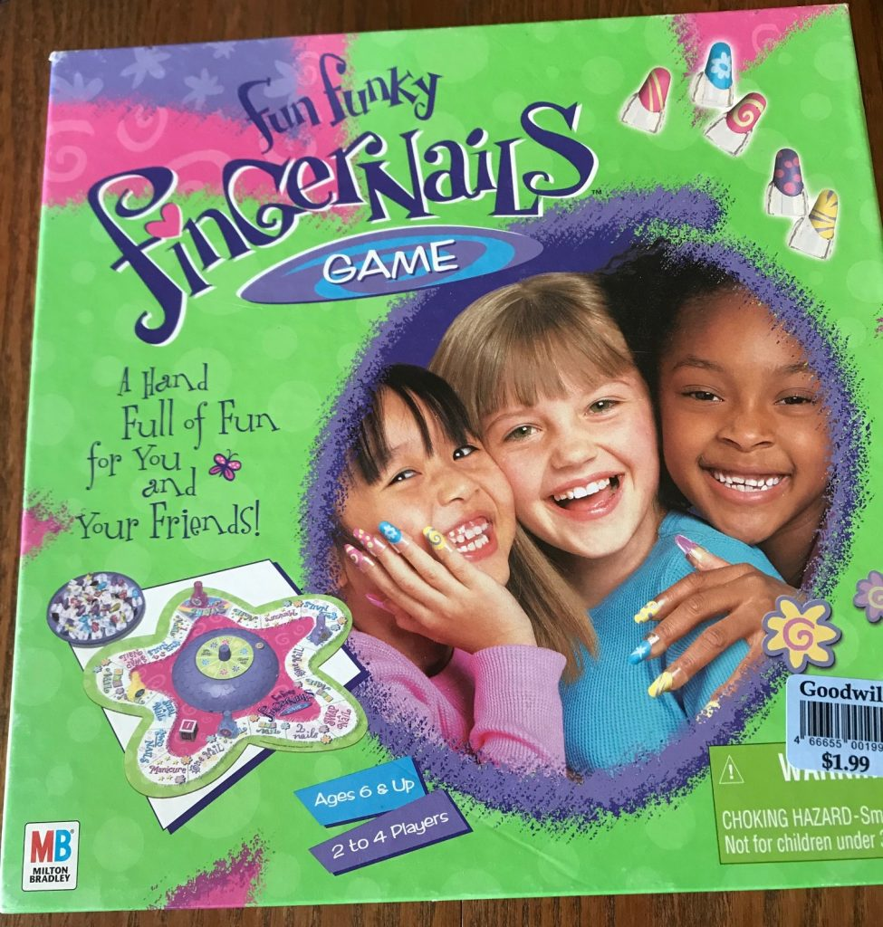 Cover shows 3 young girls wearing fake fingernails and smiling at the camera