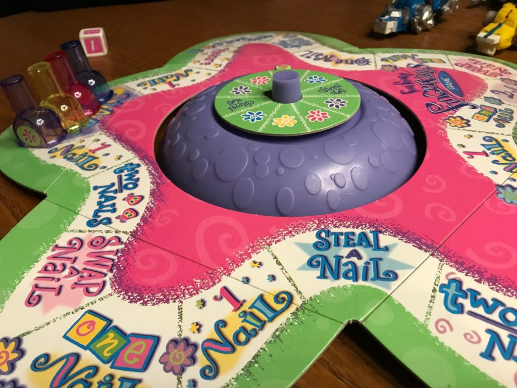 The game board with a spinner in the middle