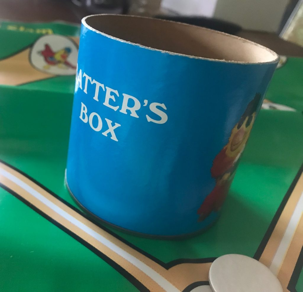 The dice cup says Batter's Box