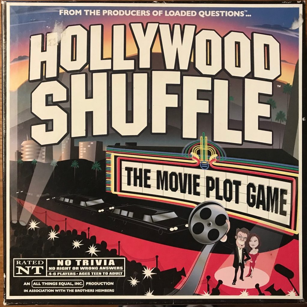 The cover mostly has the text of the game name, but it is over a red carpet with a power couple at the front and the tagline on the marquee