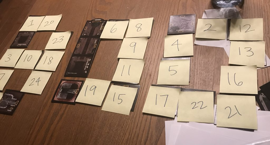 A photo of the tiles with post-its with numbers on them