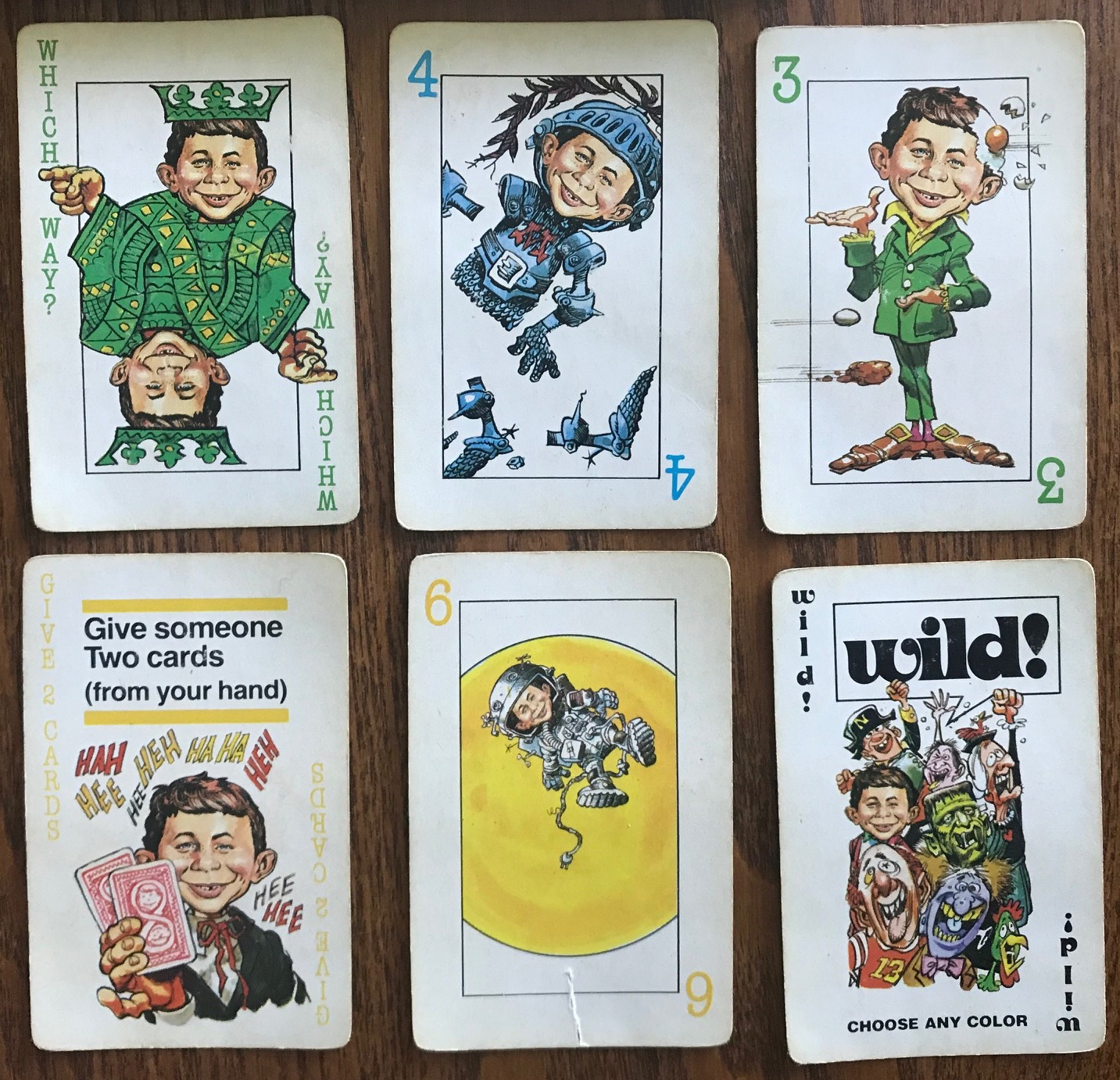 Miscellaneous cards showing a Wild, a green 3, a blue 4, a yellow 6, a Which Way