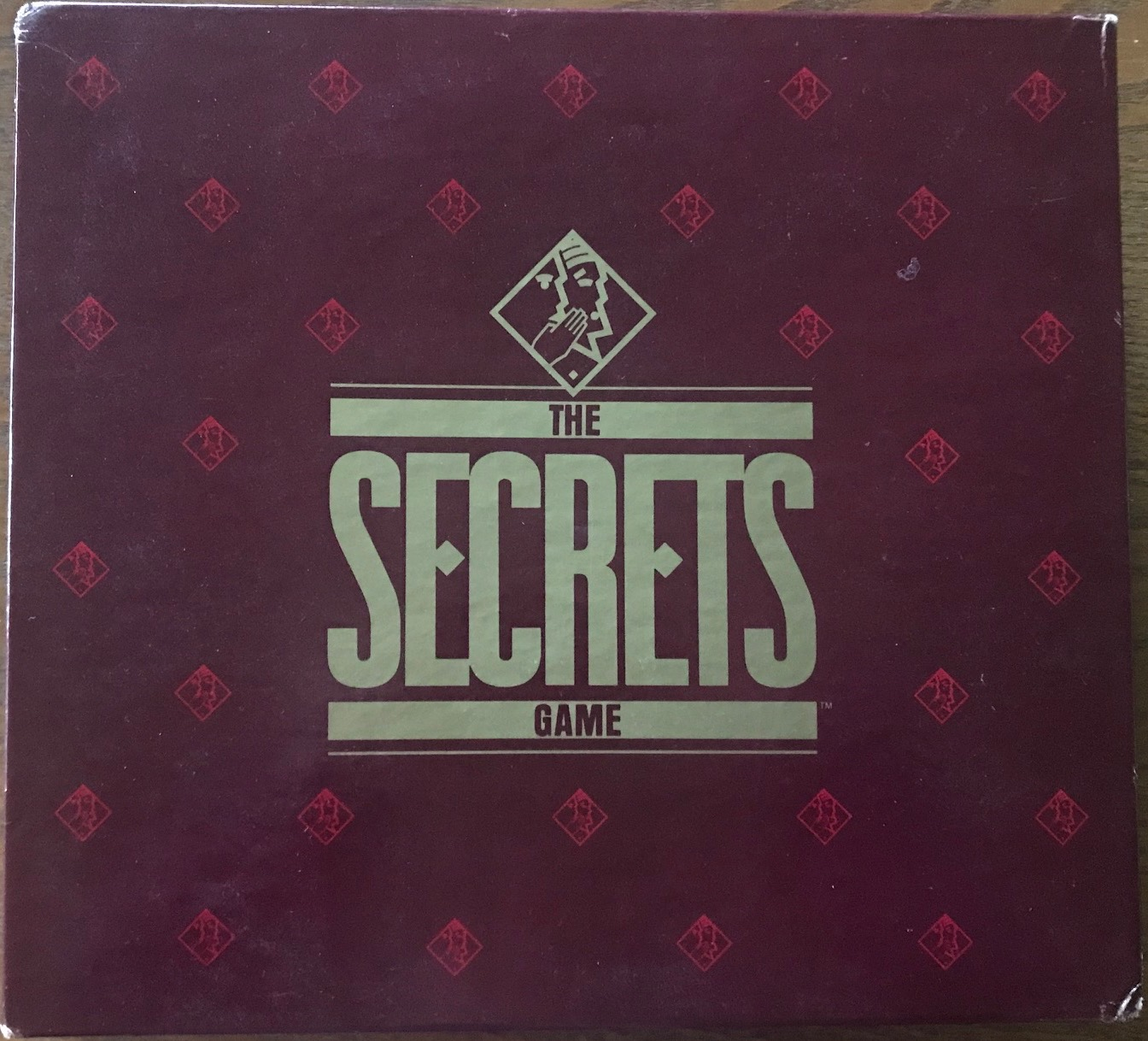 This cover is burgundy with The Secrets Game in gold