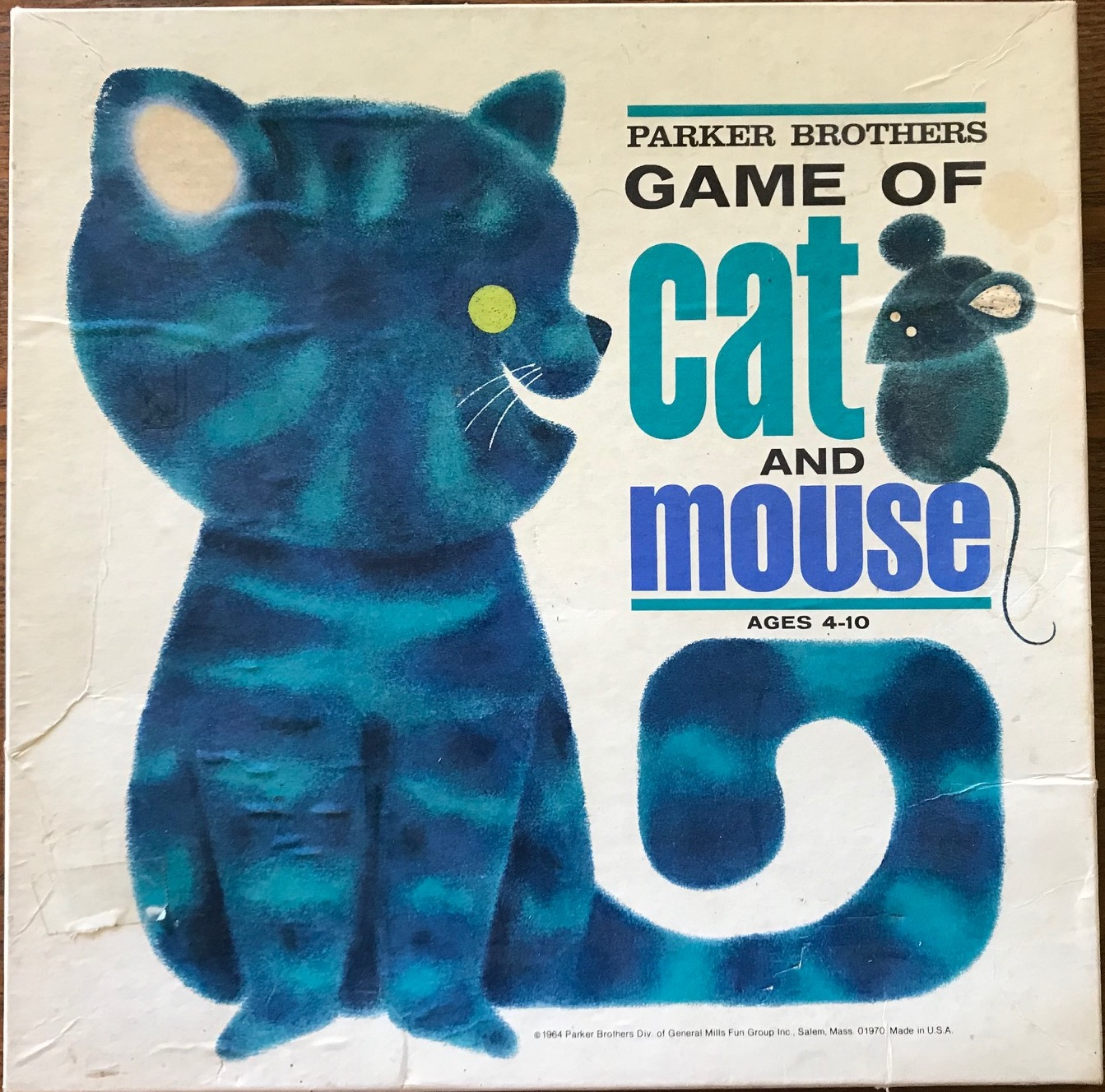 Cover has a blue kitty with the title on top of its curved tail