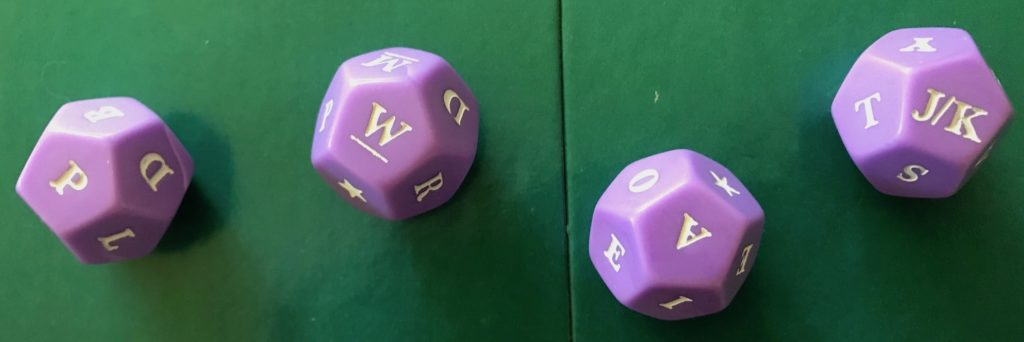 An example roll of the dice showing letters P, W, A and J/K