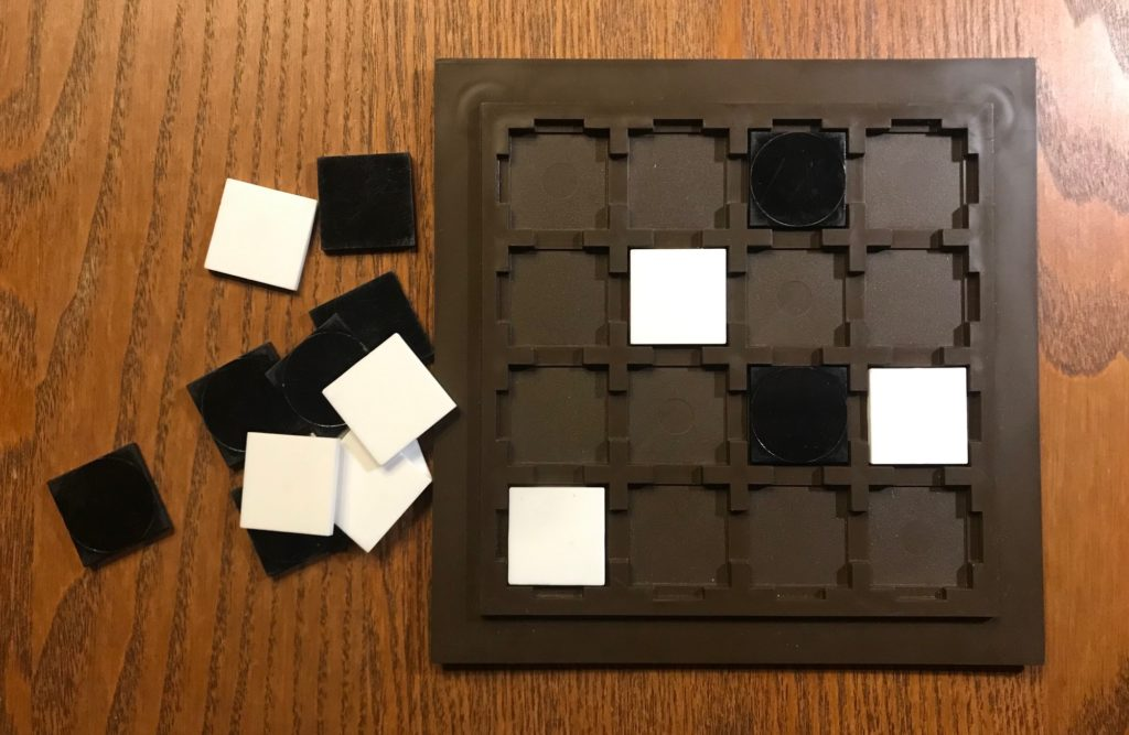 The square TABLETS on the game board, a 4x4 square