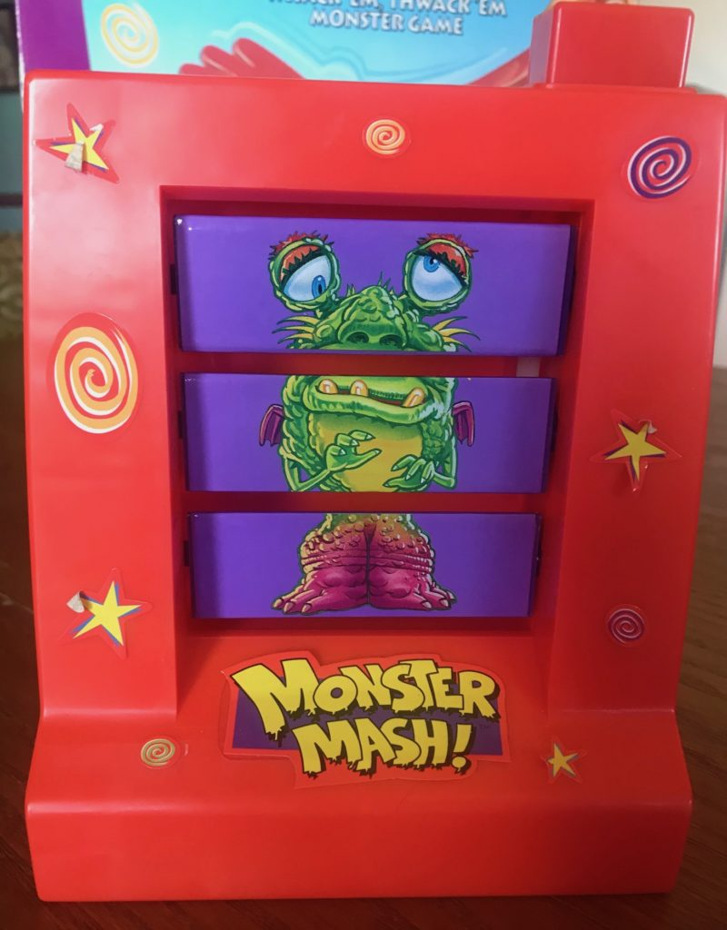 The monster machine with a large button at the top that you press, and the three sections randomize into a monster