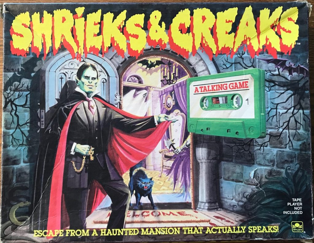 Photo shows Dracula standing at a doorway to a mansion with an audiocassette tape nearby
