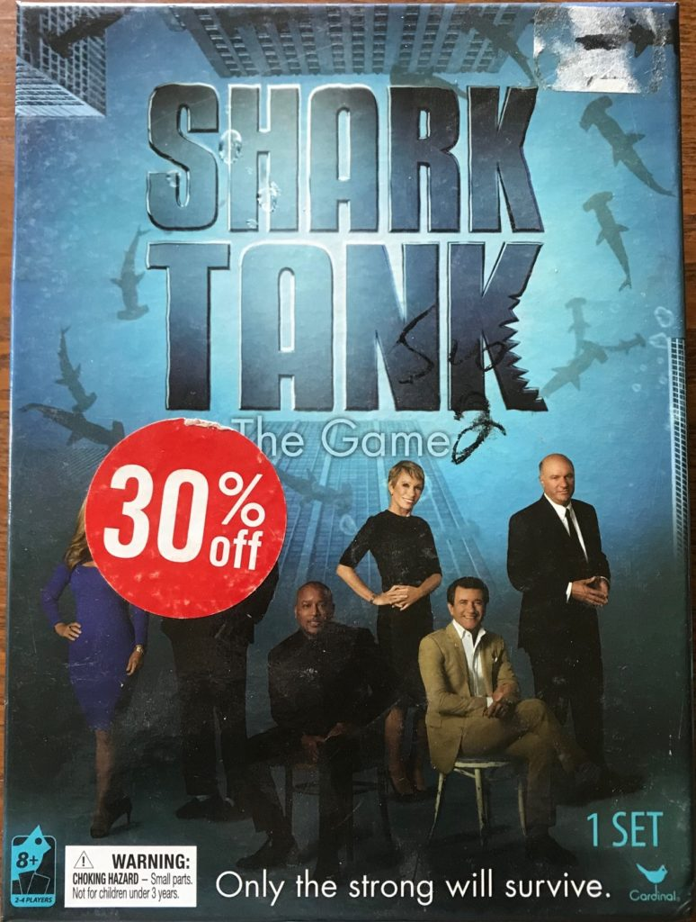 The cover shows the main sharks posed and looking toward camera