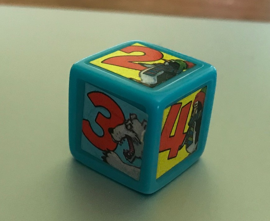 The die has either a penguin or polar bear next to a number and my photo has poor lighting